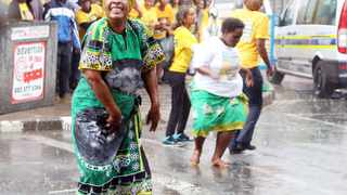 A sudden downpour in Kimberley did not dampen the spirits of ANC supporters who took to the streets of the city to celebrate their party's victory in the Northern Cape. Picture: Danie van der Lith