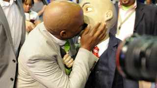 Kenny Kunene kisses Chester Missing at the IEC Election Results Centre in Pretoria. 080514. Picture: Chris Collingridge 195