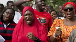 People demand for the release of the girls abducted in the remote village of Chibok, during a protest at Unity Park in Abuja. Photo: Joe Penney