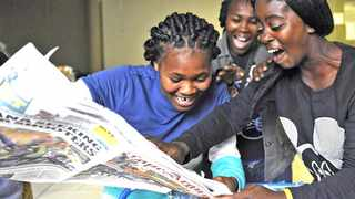 Cape Town 140108- Sinoxolo Wellem from Harry Gwala, Asanda Mazwi( friend) and Nomandla Mahlasela from Joe Slovo high celebrates after they saw their names in the Cape Argus newspaper. Matriculants  buys the Cape Argus newspaper to look for their matric results. Picture Cindy waxa.  Reporter Argus