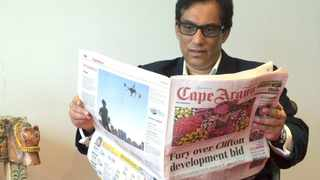 Claremont.19.5.2015. Reading the Cape Argus at his offices in Claremont is Dr Igbal Surve. To the left is the INMA Global Award for excellence in media innovation programmes which the Independent Group won in New York. Picture Ian Landsberg