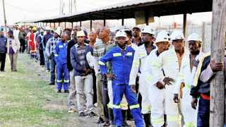 Miners at Lonmin Platinum in Rustenburg queue to enter the mine. File picture: Denis Farrell