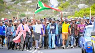 160503. Cape Town. Hundreds of Masiphumelele residents are being escorted by police along Glencairn Expy towards Simons Town court. It's believed the demonstration stems from the arrests of three community leaders who are expected in court today.Picture Henk Kruger/Cape argus