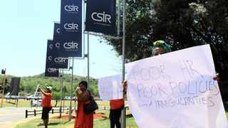 Disgruntled workers picketed at the entrance to the convention centre in Pretoria on Friday during the CSIR excellence-awards ceremony to honour employees for their outstanding performance.   Picture: Thobile Mathonsi