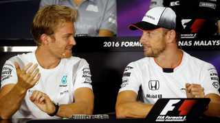Nico Rosberg, left, chats to Jenson Button at the 2016 Malaysian Grand Prix. Button, on sabbatical from McLaren, is one of the candidates for Rosberg's vacent seat at Mercedes. File photo: Edgar Su / Reuters
