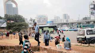 Police officers walk among civilians at the Meskel Square in Addis Ababa. Picture: Tiksa Negeri/Reuters