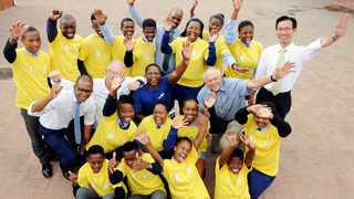 EXCITED: Masiphumulele High School pupils with principal Nelson Mafrika, David Bellairs, Jason Stone and Ken Sturgeon of the Cape Town Cycle Tour, Collen Nkune and Min-Kyn Kim of the World Mission Society Church of God and water station manager Nkanyezi Mdatyulwa. Picture: David Ritchie/African News Agency (ANA)