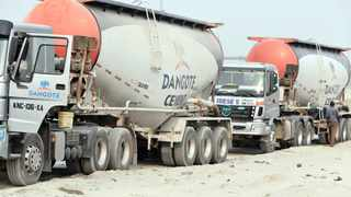 Cement trucks, operated by Dangote Cement, deliver supplies to a construction site. Photo: George Osodi/Bloomberg