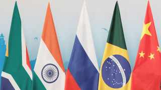 The flags of South Africa, India, Russia, Brazil and China are displayed at a BRICS conference. Picture: Reuters/Tyrone Siu