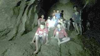 Six schoolboys have been rescued so far from a flooded Thai cave after divers launched a dangerous mission to free the boys and the soccer coach. Picture: AP