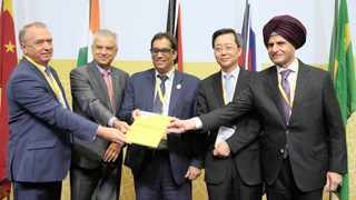 BRICS Business Council leaders Sergey Ktyrin (Russia), Paulo Cesar de Silva eSouza (Brazil), Dr Iqbal Survé (South Africa), Xu Lirong (China) and Onkar Kanwar (India) after signing the annual report following its adoption in Durban yesterday.Picture: Motshwari Mofokeng/ African News Agency (ANA)