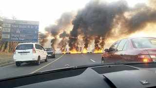 Motorists travelling to work on Tuesday were caught in a traffic jam on the N2 Durban-bound after protesters burnt tyres on the freeway. Police were clearing a similar incident on the N2 at Umbogintwini.