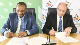 Municipal manager Moeketsi Mosola and TUT vice-chancellor and principal Lourens van Staden sign a memorandum of understanding between the two institutions yesterday. Picture: Oupa Mokoena/African News Agency (ANA)