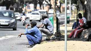 Workers waiting for short-term job opportunities.     Henk Kruger  African News Agency (ANA)