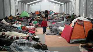A migrant boy, part of a caravan of thousands travelling from Central America en route to the US, walks through a makeshift camp in Mexico City, Mexico, yesterday, as US President Donald Trump claimed an election victory for the Republicans. Photo: Reuters