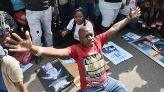 Members of the Enlightened Christian Gathering Church led by fraud and money laundering accused Shepherd Bushiri and his wife Mary, show support by singing and praying outside the Specialised Commercial Crimes Court in Tshwane.  Picture: Oupa Mokoena/African News Agency (ANA)