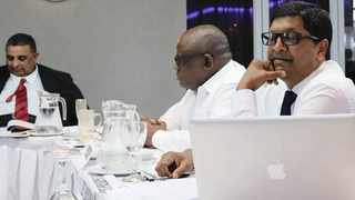 Members of Volleyball SA's brains trust, which includes Siven Samuel (left, legal adviser), Anthony Mokoena (president) and Kriba Reddy (vice-president), in discussion.
