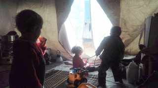Children play inside a tent that is now the home a Cape Town woman living in the al-Hol camp in Syria.
