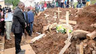 President Cyril Ramaphosa lays a wreath at the debris of a house where eight bodies, including children, were retrieved in Chatsworth near Durban. Picture: Rogan Ward/Reuters/African News Agency (ANA)