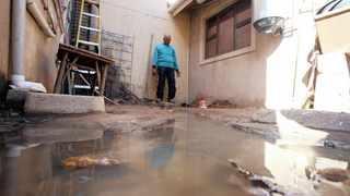 """MARIEMUTHU Maduray stands in his neighbour's backyard where sewage seeps through to his property.  The indignity of having to scoop up raw sewage flooding their homes """"by hand"""" drove the community of ward 13 in Imbali, outside Pietermaritzburg, to a violent protest that has lasted for two days, resulting in clashes with the police.  SIBUSISO NDLOVU  African News Agency (ANA)"""