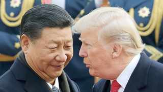 US President Donald Trump, right, speaks with Chinese President Xi Jinping during a welcome ceremony at the Great Hall of the People in Beijing in November 2017.  File picture: Andy Wong/ AP