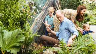 Prince William and Catherine, Duchess of Cambridge with Prince George and Prince Louis explore the Adam White and Andree Davies co-designed garden ahead of the RHS Chelsea Flower Show in London. Picture: Reuters