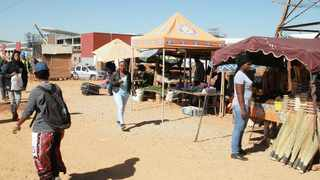 INFORMAL traders at Denneboom railway station have vowed to stay put despite a court order that they vacate the area within 48 hours.     Jacques Naude  African News Agency (ANA)