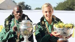 COMRADES Marathon winners Edward Mothibi and Gerda Steyn with their trophies yesterday at Scottsville Racecourse in Pietermaritzburg. While Steyn dominated the women's race, breaking the six-hour barrier for women, Mothibi hung on to his lead to finish ahead of Bongmusa Mthembu.     Motshwari Mofokeng African News Agency (ANA)