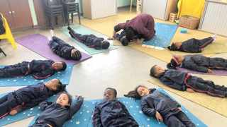 Merrydale Primary School's Grade R learners practise meditation in class. Research has shown that practising yoga regularly leads to better mental, physical and intellectual health. Photo: Odwa Mkentane