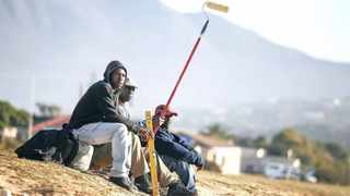 Unemployed builders and painters wait on a roadside in the hope of finding work. The writer says at the moment, the South African government is slowly but surely suffocating businesses' ability to create jobs by continuously adding more and more burdens on both employers and the unemployed. Photo: EPA