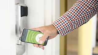 A smartphone is used as a digital hotel room key. Hilton has installed its Digital Key technology at more than 4250 properties over the past five years. Picture: The New York Times