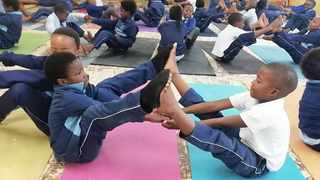 Children in Khayelitsha take yoga lessons to help deal with everyday challenges at school.     Supplied