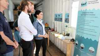 Centre for Environment, Fisheries and Aquaculture Science principal marine litter scientist Thomas Maes explains the CLiP programme to the Duke and Duchess of Sussex, Prince Harry and Meghan, in Cape Town this week. Photo: Centre for Environment, Fisheries and Aquaculture Science