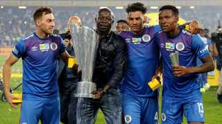 Bradley Grobler, coach Kaitano Tembo (with trophy), Clayton Daniels and Thamsanqa Gabuza hold the MTN8 trophy after beating Highlands Park in the final at Orlando Stadium on Saturday. Photo: Gavin Barker/BackpagePix