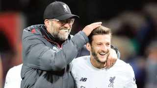 Liverpool manager Jurgen Klopp (left) celebrates with Adam Lallana after a Premier League match at Old Trafford, Photo: Martin Rickett/PA Wire