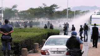 Stun grenades and water cannon are used to disperse student protesters at UWC main gate.     SISONKE MLAMLA