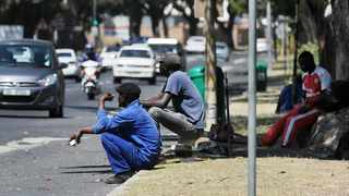 Labourers desperate for short-term work opportunities wait in vain. Pressure is on Finance Minister Tito Mboweni over plans to deal with unemployment in his Medium-Term Budget Policy Statement today. Picture: Henk Kruger/African News Agency (ANA)