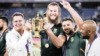 Rassie Erasmus and RG Snyman pose with the Webb Ellis Cup at the Rugby World Cup Final in Japan on Saturday. Photo: Matthew Childs/Reuters