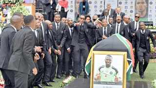 MEMBERS of Orlando Pirates soccer team singing songs at the funeral of captain Senzo Meyiwa at Moses Mabhida Stadium in Durban on November 1, 2014, in this GCIS image handout.     Elmond Jiyane  EPA  African News Agency (ANA)