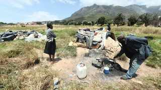 SEVERAL refugees and homeless people have invaded land that is part of the District Six restitution process. Picture: Courtney Africa/African News Agency (ANA)