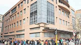 People queue outside a Sars office. Trust in the government, not tax rates, determines citizens' attitude to taxation, says the writer.     Tracey Adams African News Agency (ANA)