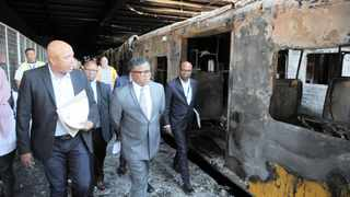 Transport Minister Fikile Mbalula and Passenger Rail Agency of SA officials conduct an inspection at Cape Town station after 18 train carriages were burnt. Picture: Armand Hough/African News Agency (ANA)