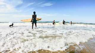 Children from disadvantaged backgrounds are learning to surf through the Small Steps Surfing initiative.
