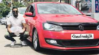 Aldayne Ramsamy, 23, next to his lowered VW Polo, holding the multiple fines a traffic officer gave him.