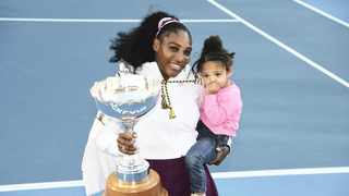 Serena Williams poses with her daughter Alexis Olympia Ohanian Jr and her ASB trophy after she beat Jessica Pegula in the final in Auckland, New Zealand yesterday. Photo: Chris Symes/Photosport via AP