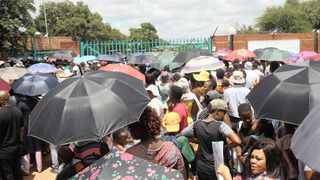 A large crowd of parents whose children had not yet been placed in schools by yesterday gathered outside the Department of Education's Tshwane West District offices.    Jacques Naude African News Agency (ANA)