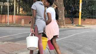 Children were among the thousands of people fetching water from municipal trucks and tankers in Sunnyside and other areas within the CBD that have been hit by a water crisis since Thursday night.    Picture: Val Boje