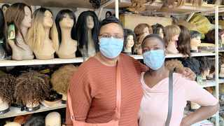 Perserverance Muchaonerwa and Mashego Mantsie wearing face masks at the Dragon City Wholesale Mall in Johannesburg. Picture: Bhekikhaya Mabaso African News Agency (ANA)