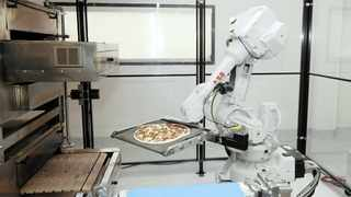 A ROBOT places a pizza into an oven at a pizzeria in California. Certain jobs, particularly those that involve routine, repetitive tasks, stand a high probability of being automated in the next 20 years. Schroders' Gavin Ralston says because lower-skilled jobs will suffer more than higher-skilled jobs, the rise in automation will exacerbate social inequality.     AP