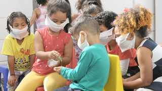 Pre-schoolers at Happy Valley Daycare in Strandfontein have been taught good hand sanitising practices as well as why wearing masks made from wet wipes can help prevent the spread of the coronavirus. Picture: Tracey Adams/African News Agency (ANA)